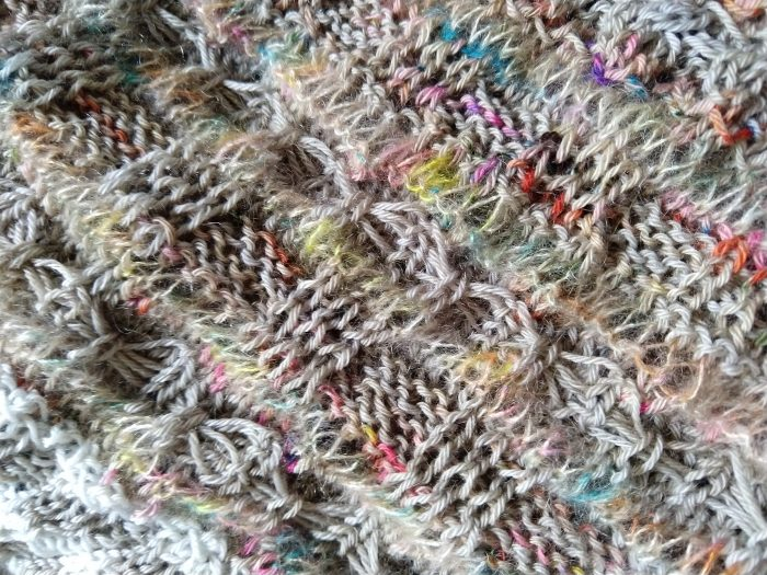 a close up of the knitted wrap showing another texture