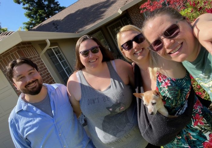 from left to right: Kirk, Lindsey, Kira (holding Poppy the dog in her sling), and Deborah