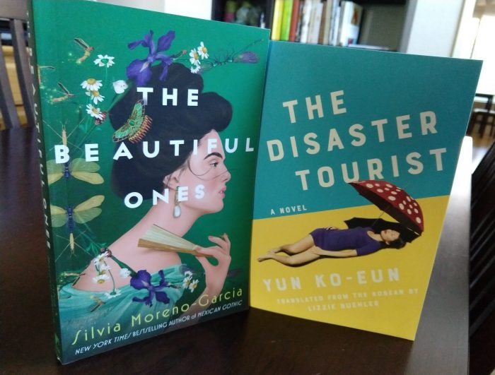 two paperback books: The Beautiful Ones by Silvia Moreno-Garcia and The Disaster Tourist by Yun Ko-Eun