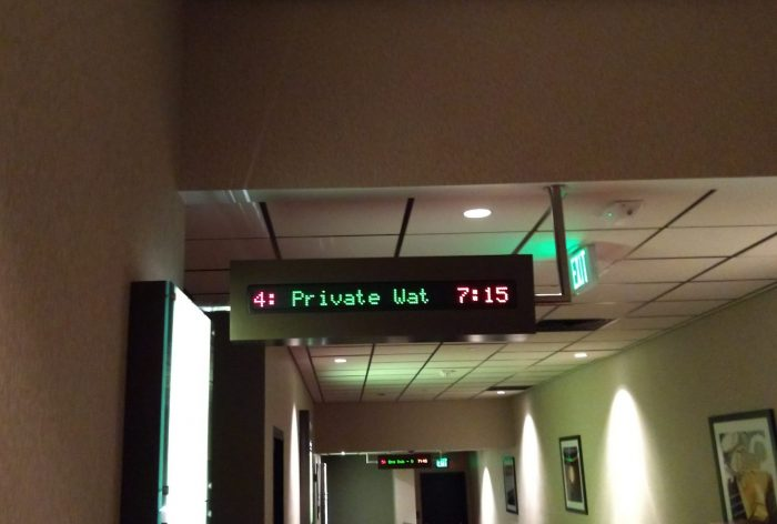 """a sign in a movie theatre that says """"private wat 7:15"""" at the door to our theatre"""