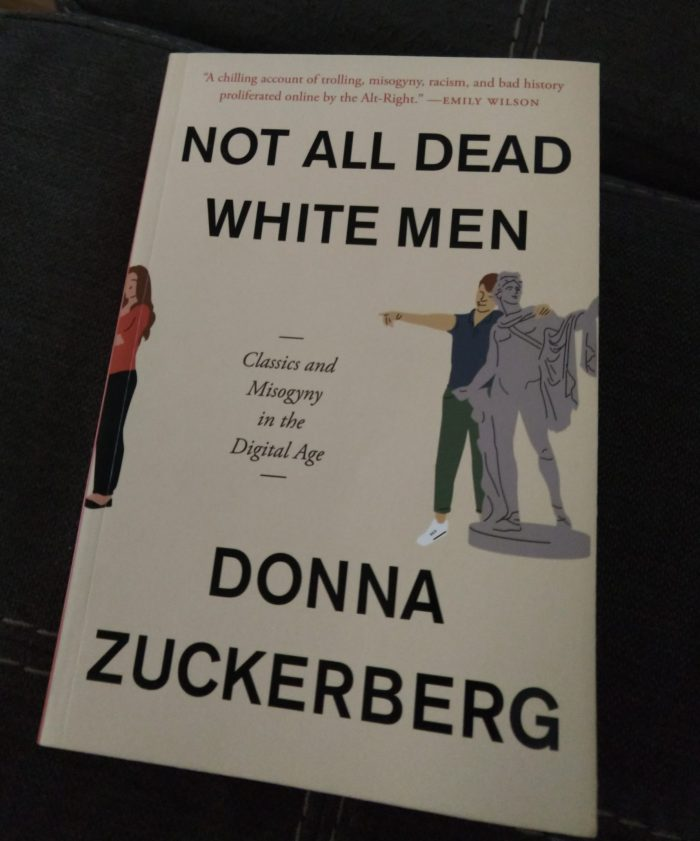 book: Not All Dead White Men by Donna Zuckerberg. Cover shows an illustration of a man affectionately putting an arm around a classical statue and pointing at a woman