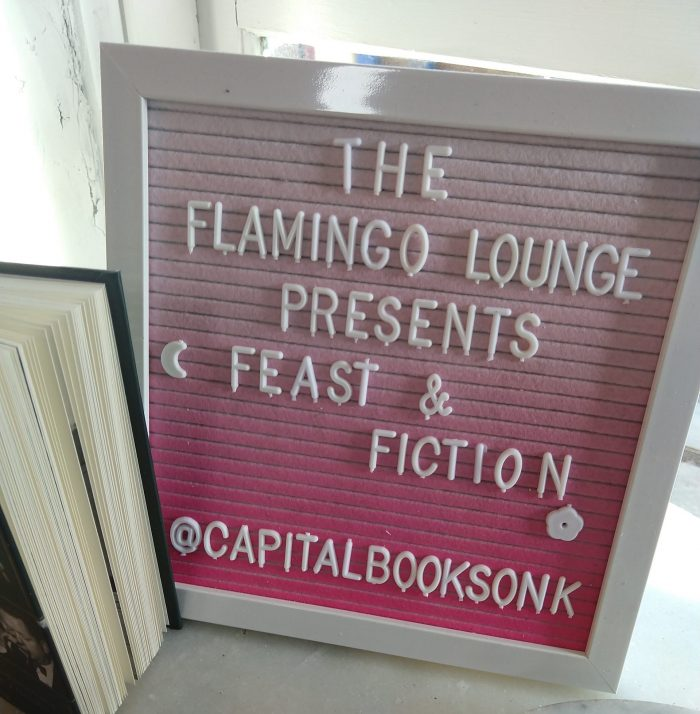 """a sign with push-in letters that says """"The Flamingo Lounge presents Feast & Fiction. @CapitalBooksOnK"""""""
