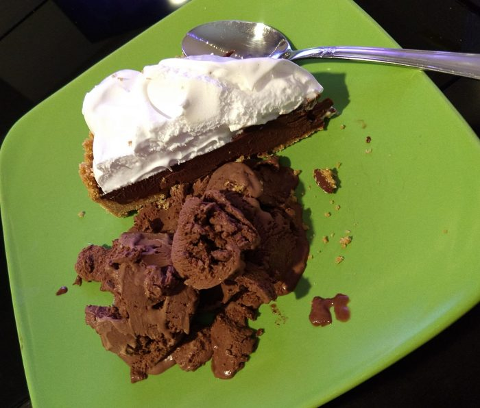 a plate with a slice of pie (graham cracker crust, chocolate ganache filling, and swiss merengue topping) and a bit of chocolate ice cream