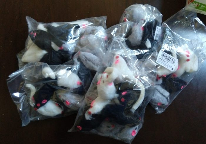 five bags of about 12 toy mice each