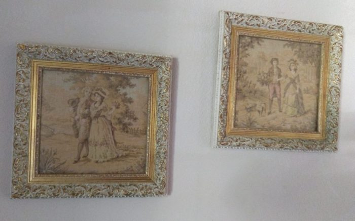 two faded needpoints, about 8 by 8 inches each, of maybe 18th century styled couples walking in nature